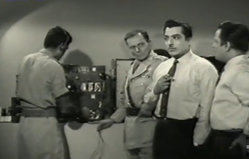 Two security agents Ashok (Pradeep Kumar) and Mirza (Anwar Hussain) follow a counterintelligence tip about enemy spies trying to smuggle the country's classified information through a microfilm in this espionage drama directed by the doyen of B-grade cinema, NA Ansari. He also stars in it as the ruthless antagonist who for some strange reason has a figurine of a man hanging by the noose on his work desk.