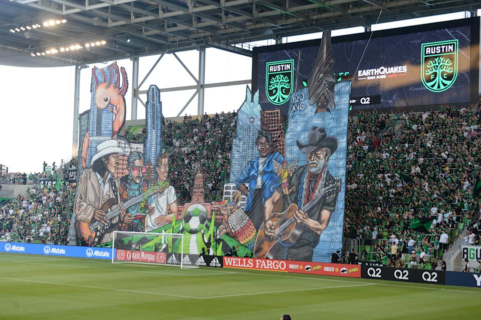 Austin FC supporters rolled out a tifo featuring icons of the city on Saturday. (Photo by John Rivera/Icon Sportswire via Getty Images)