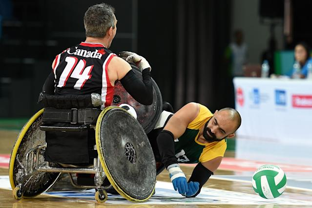 RIO DE JANEIRO, BRAZIL - FEBRUARY 26: Alexandre Vitor Giuriato of Brazil competes against David James Willsie of Canada during the International Wheelchair Rugby Championship - Aquece Rio Test Event for the Rio 2016 Paralympics match between Brazil and Canada at Olympic Park on February 26, 2016 in Rio de Janeiro, Brazil. (Photo by Buda Mendes/Getty Images)
