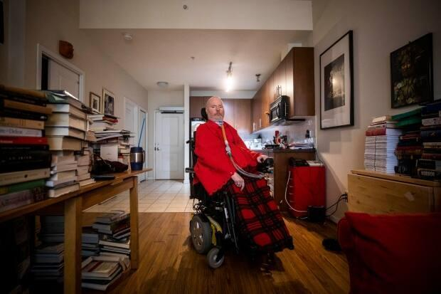 'Many disabled people during the heat dome, because of poverty and because of depending on others to survive, were presented with this impossible choice ... damned if you do and damned if you don't,' said Paul Caune, who found himself isolated during the summer's extreme heat. (Ben Nelms/CBC - image credit)
