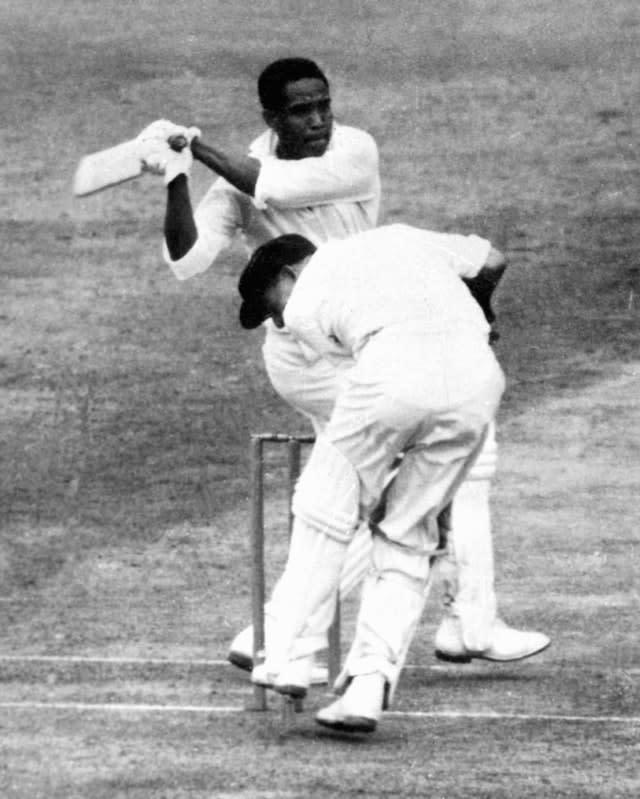 Sir Garfield Sobers hits out on his way to 168 against Australia in 1961 (PA)