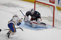 Columbus Blue Jackets' Elvis Merzlikins, right, makes a save against Buffalo Sabres' Linus Weissbach during the second period of a preseason NHL hockey game Tuesday, Sept. 28, 2021, in Columbus, Ohio. (AP Photo/Jay LaPrete)