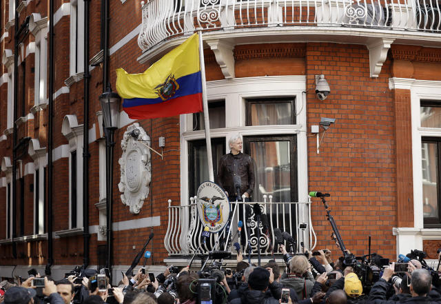 <p>WikiLeaks founder Julian Assange gestures on the balcony of the Ecuadorian embassy prior to speaking, in London, May 19, 2017. Assange has won his battle against extradition to Sweden, which wanted to question him about a rape allegation. He has spent nearly five years inside the Embassy of Ecuador in London to avoid being sent to Sweden, which announced Friday that the investigation has been discontinued. (Photo: Matt Dunham/AP) </p>