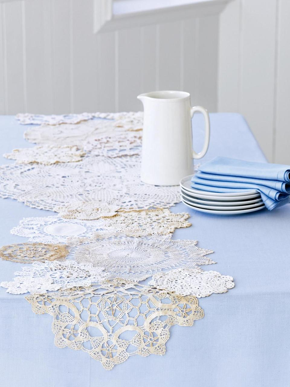 """<p>In the Victorian era, you'd have been hard-pressed to find a table that wasn't topped with a crocheted doily. Today, these handmade bits of lace (which to us look like delicate snowflakes) are more likely to be tucked away in linen closets or piled up at yard sales. Give them a flurry of new life this winter by turning them into a country-chic table runner. </p><p><strong><a class=""""link rapid-noclick-resp"""" href=""""https://go.redirectingat.com?id=74968X1596630&url=https%3A%2F%2Fwww.ebay.com%2Fb%2FAntique-Lace-Crochet-Doilies%2F39445%2Fbn_16561727&sref=https%3A%2F%2Fwww.goodhousekeeping.com%2Fholidays%2Fchristmas-ideas%2Fhow-to%2Fg2196%2Fchristmas-table-settings%2F"""" rel=""""nofollow noopener"""" target=""""_blank"""" data-ylk=""""slk:SHOP VINTAGE DOILIES"""">SHOP VINTAGE DOILIES</a></strong></p>"""