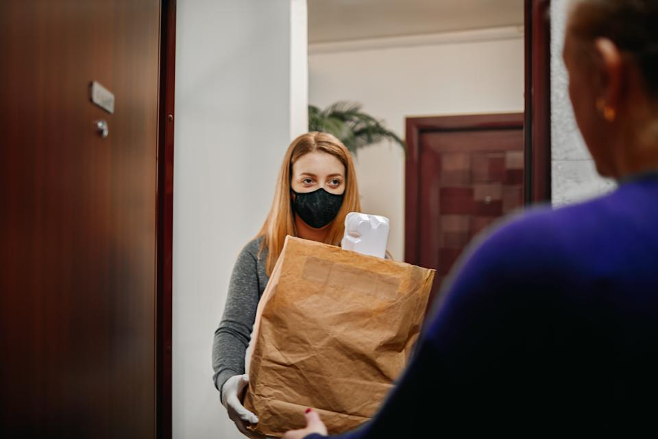 Americans are depending on delivery workers to bring essentials like groceries, prescription and goods to make quarantine life due to COVID-19 more comfortable. (Photo: Getty)