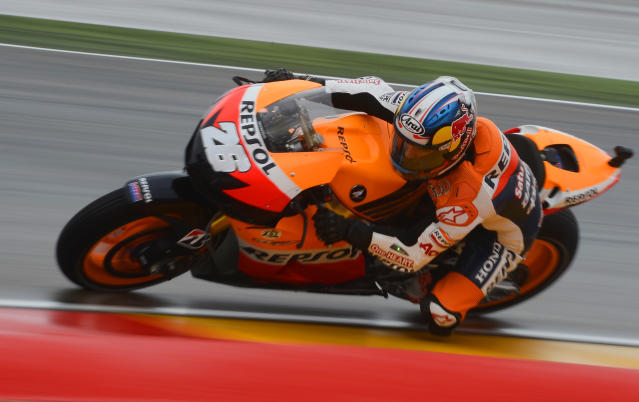 Repsol Honda Spanish rider Dani Pedrosa takes a curve during the Moto GP second free practice session at Motorland's race track in Alcaniz on September 28, 2012, two days ahead of the Aragon MotoGP. AFP PHOTO/ PIERRE-PHILIPPE MARCOUPIERRE-PHILIPPE MARCOU/AFP/GettyImages
