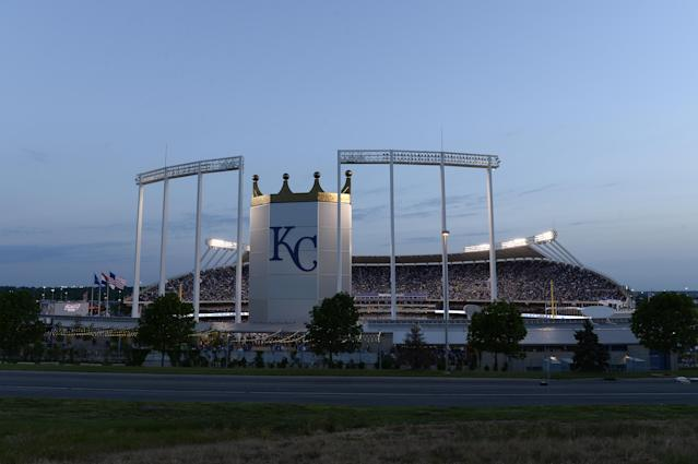 A fan was hit in the face by a foul ball on Saturday night at Kauffman Stadium, which does not yet have extended netting. (John Williamson/Getty Images)