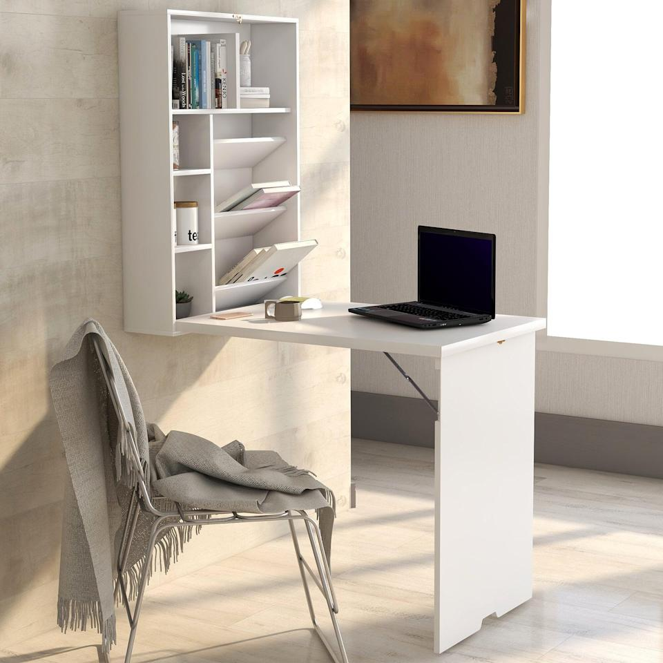 <p>You can fold up this <span>Mitcham Floating Desk With Hutch</span> ($150) when you're not using it.</p>