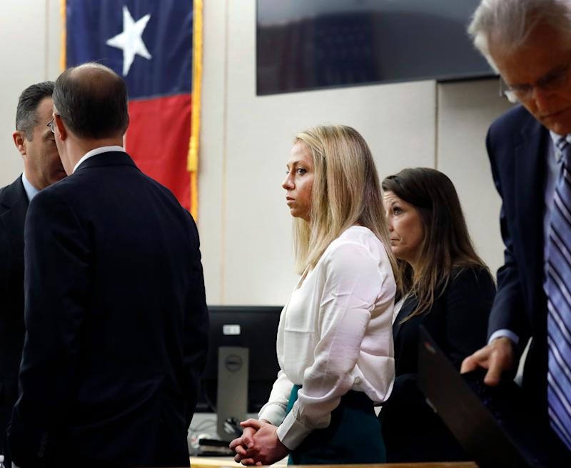 Amber Guyger, center, appears in court on Sept. 28, 2019, in Dallas.