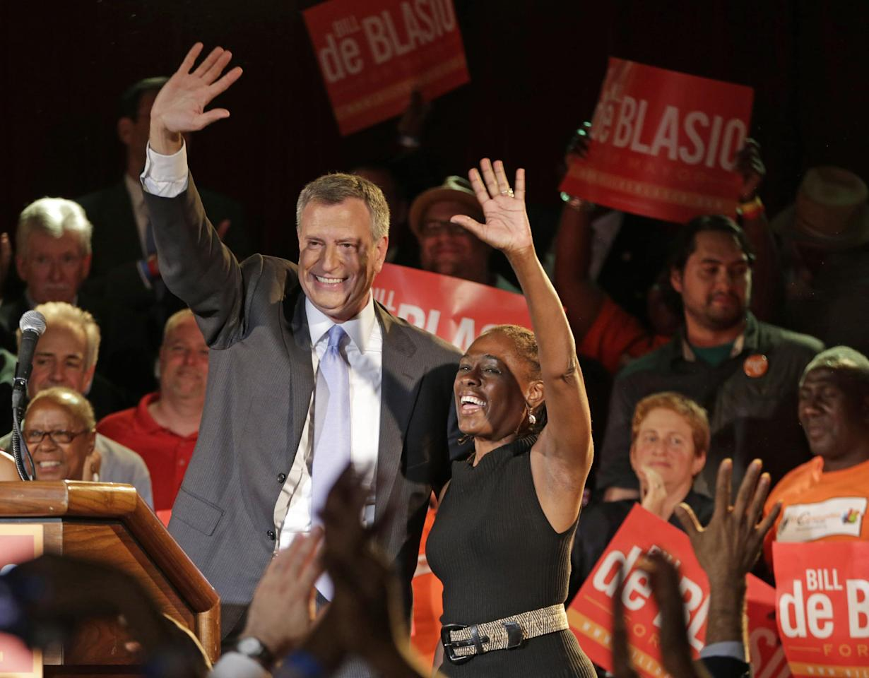 New York City Democratic Mayoral hopeful Bill De Blasio celebrates on stage with his wife Chirlane, right, after addressing supporters at his election headquarters after polls closed in the city's primary election Wednesday, Sept. 11, 2013, in New York. (AP Photo/Kathy Willens)