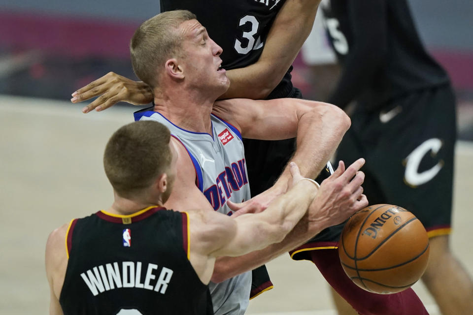 Cleveland Cavaliers' Dylan Windler, left, knocks the ball loose from Detroit Pistons' Mason Plumlee in the second half of an NBA basketball game, Wednesday, Jan. 27, 2021, in Cleveland. (AP Photo/Tony Dejak)