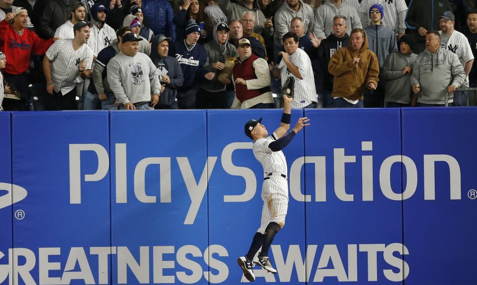 New York Yankees' Aaron Judge makes a leaping catch of a ball hit by Houston Astros' Yuli Gurriel during the fourth inning of Game 3 of baseball's American League Championship Series Monday, Oct. 16, 2017, in New York. (AP)