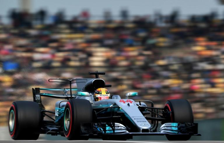 Mercedes' British driver Lewis Hamilton drives during the qualifying session for the Formula One Chinese Grand Prix in Shanghai