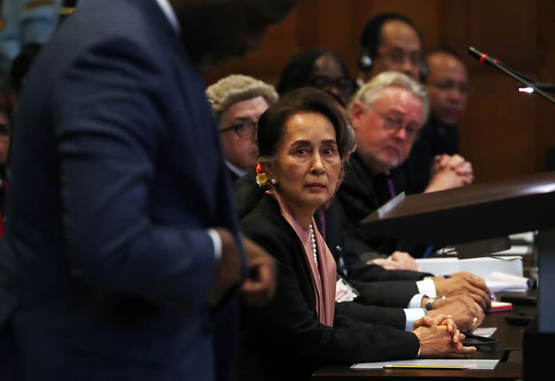 Suu Kyi in court as genocide case set out against Myanmar