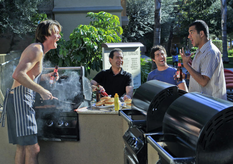 "This publicity image released by CBS shows, from left, Jerry O'Connell, Tony Shalhoub, Chris Smith, and Kal Penn in a scene from ""We Are Men."" CBS is canceling the freshman sitcom ""We Are Men."" The Monday night comedy about four bachelors failed to gain traction with viewers and is now among the new season's early ratings casualties. (AP Photo/CBS, Sonja Flemming)"