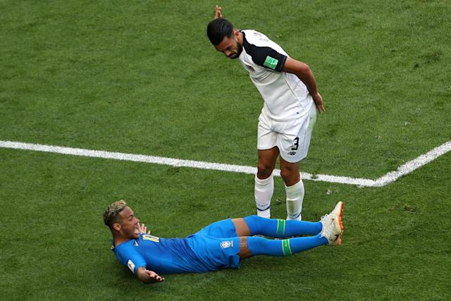 Brazil's Neymar goes down in the penalty area following a challenge from Costa Rica's Giancarlo Gonzalez. (Reuters)