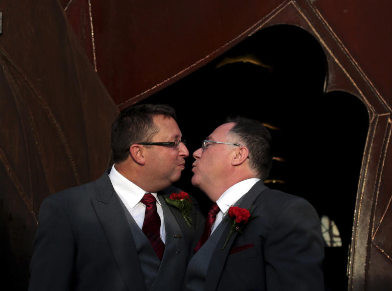 Australian Minister Ian Hunter, right and Leith Semmens prepare to kiss outside the Pabellon de los Artes center after getting married in the town of Jun, southern Spain, Wednesday Dec. 19, 2012. Ian Hunter, the social inclusion minister for the state of South Australia,  married his longtime partner Wednesday in southern Spain, two months after his country voted down a proposal to enact same sex marriage legislation. Hunter, 52, is believed to be the first sitting member of an Australian legislative body to marry a gay partner. Hunter said he was disappointed that his marriage to artist Leith Semmens won't be legal in Australia but said the two decided they couldn't wait for their country to approve a gay marriage law. (AP Photo/Sergio Torres)
