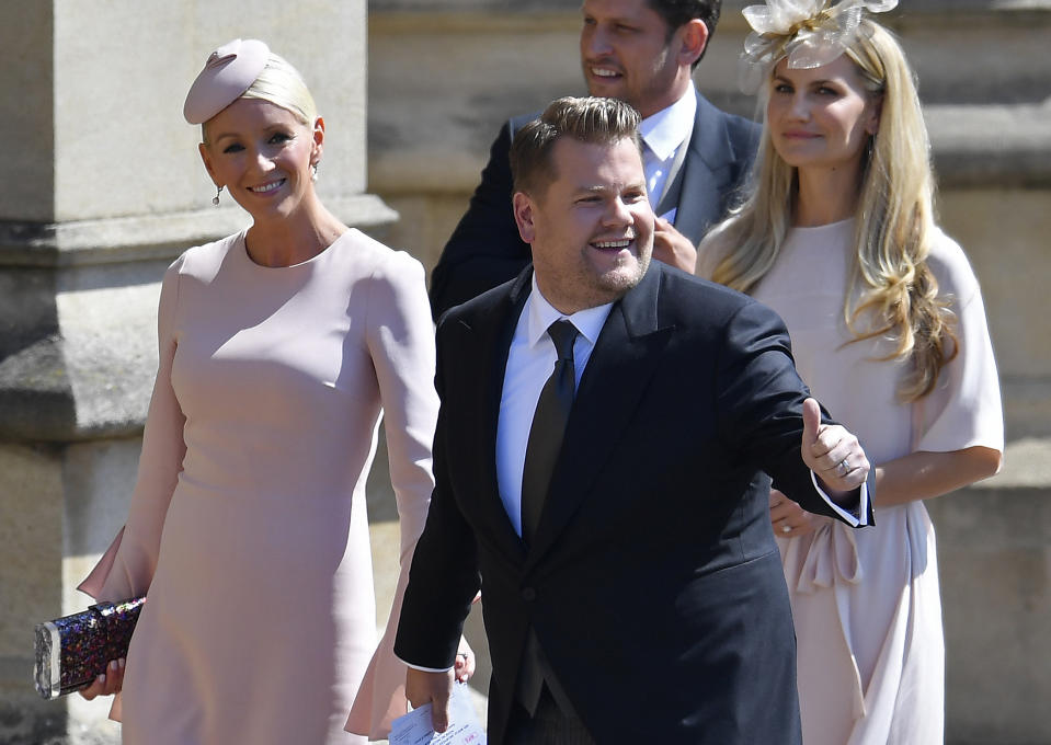 British presenter James Corden and Julia Carey arrive for the wedding ceremony of Britain's Prince Harry, Duke of Sussex and US actress Meghan Markle at St George's Chapel, Windsor Castle, in Windsor, on May 19, 2018. (Photo by TOBY MELVILLE / POOL / AFP)        (Photo credit should read TOBY MELVILLE/AFP via Getty Images)