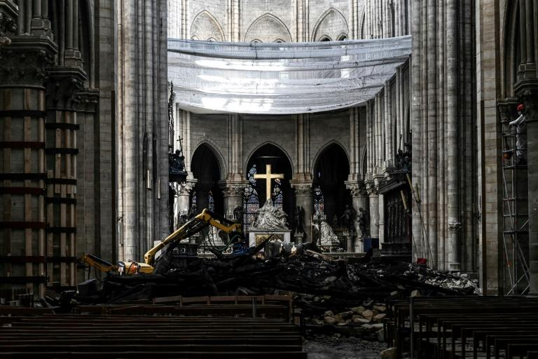 The rubble-strewn interior of Notre Dame a month after the April 15 fire (AFP Photo/Philippe LOPEZ)