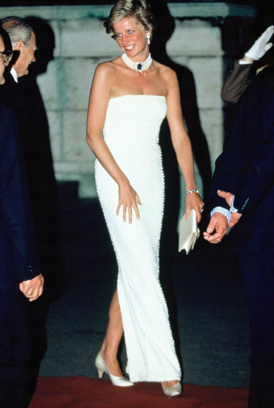 <p>The Princess wore a strapless white gown by Catherine Walker with statement jewelry while attending a state banquet during an official visit to Hungary. </p>