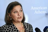 Victoria Nuland, seen on a 2016 visit to Greece, has been named as number three at the State Department and is known for her hard line on Russia