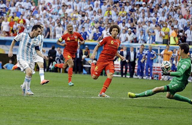 Belgium's goalkeeper Thibaut Courtois makes a stop on a shot by Argentina's Lionel Messi during the World Cup quarterfinal soccer match at the Estadio Nacional in Brasilia, Brazil, Saturday, July 5, 2014. (AP Photo/Kirsty Wigglesworth)