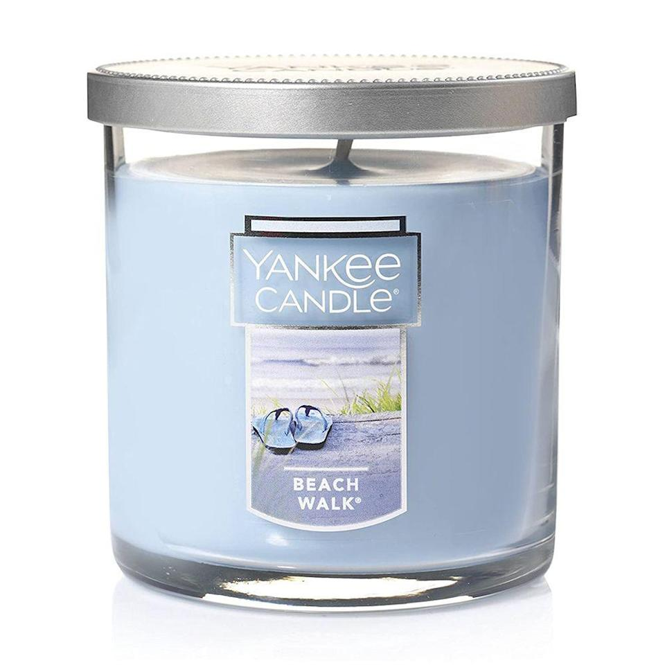 "<p><strong>Yankee Candle</strong></p><p>amazon.com</p><p><strong>$8.49</strong></p><p><a href=""https://www.amazon.com/dp/B0037MHNNK?tag=syn-yahoo-20&ascsubtag=%5Bartid%7C10055.g.35996140%5Bsrc%7Cyahoo-us"" rel=""nofollow noopener"" target=""_blank"" data-ylk=""slk:Shop Now"" class=""link rapid-noclick-resp"">Shop Now</a></p><p>Bet you didn't know you can get the beloved Yankee Candle brand on Amazon! You can get the Beach Walk scent, along with <a href=""https://www.amazon.com/stores/Yankee+Candle/page/85C5AA5C-DBEE-49BE-8769-F3BA527A0204?tag=syn-yahoo-20&ascsubtag=%5Bartid%7C10055.g.35996140%5Bsrc%7Cyahoo-us"" rel=""nofollow noopener"" target=""_blank"" data-ylk=""slk:others"" class=""link rapid-noclick-resp"">others</a>, in a range of sizes. If there's one thing we can all agree on, it's that you can never have too many candles.</p>"