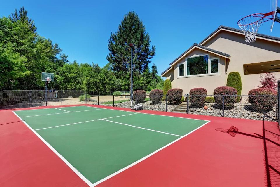 """If you've got a sizable property and are under the impression you could dunk on <strong>LeBron James</strong>, you might consider adding a basketball court to your outdoor space. That said, adding any kind of athletics-specific outdoor area is a poor choice. """"The square footage it takes up isn't worth it, and a new buyer will just come in and rip that right out,"""" says Lackaff-Gilligan. And when you break it down, adding in that court is a seriously expensive mistake. It could cost you tens—if not hundreds—of thousands of dollars due to the clear-cutting, paving, running electricity, and building of the space."""