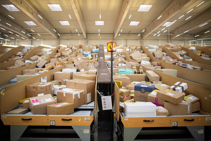 18 September 2019, Berlin: Many parcels are stored in a parcel centre run by Deutsche Post and DHL. Photo: Tom Weller/dpa (Photo by Tom Weller/picture alliance via Getty Images)