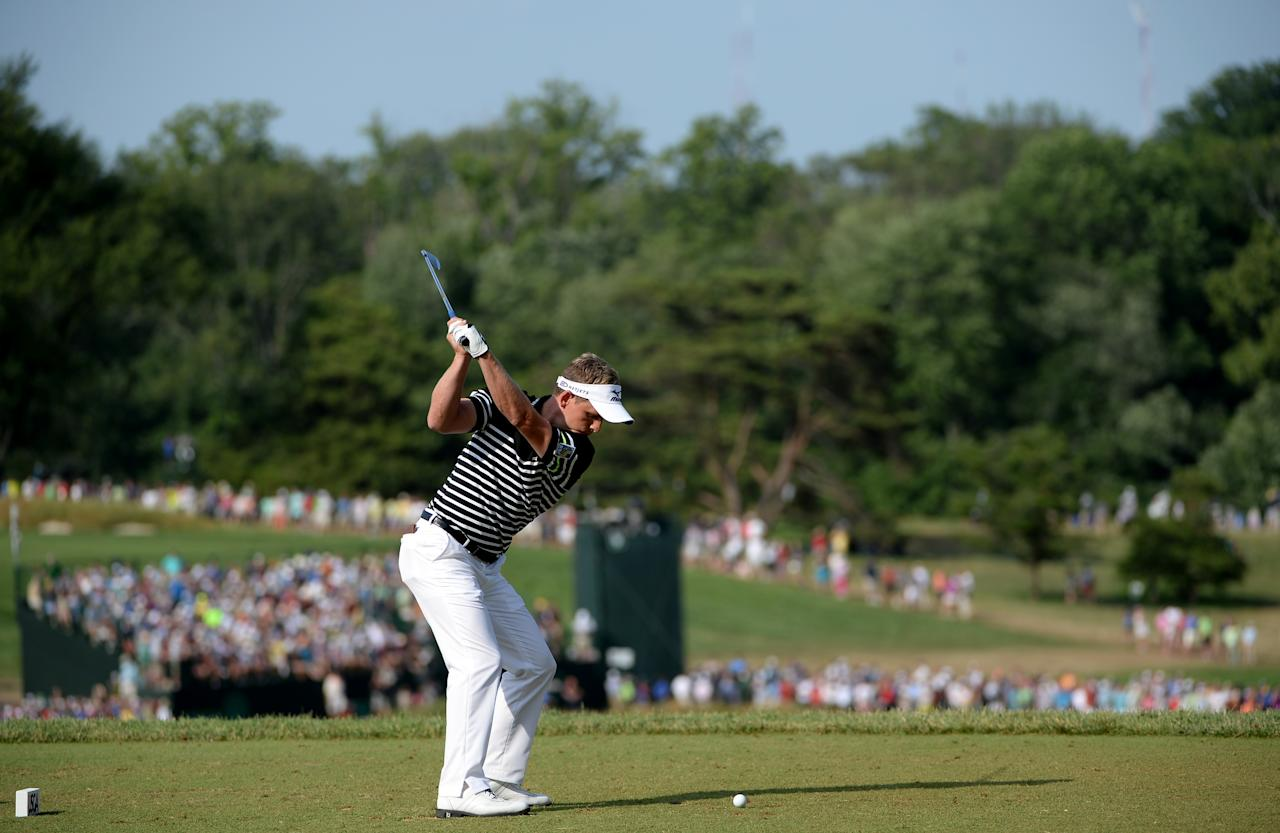 ARDMORE, PA - JUNE 15: Luke Donald of England hits his tee shot on the ninth hole during Round Three of the 113th U.S. Open at Merion Golf Club on June 15, 2013 in Ardmore, Pennsylvania.  (Photo by Ross Kinnaird/Getty Images)