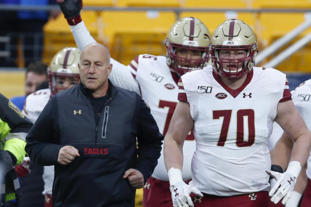 FILE - In this file photo from Nov. 30, 2019, Boston College head coach Steve Addazio, left, takes the field with offensive lineman John Phillips (70) and the rest of the team to play against Pittsburgh in an NCAA college football game, in Pittsburgh. Boston College fired Addazio on Sunday, Dec. 1, after seven seasons in which the Eagles never surpassed seven wins. (AP Photo/Keith Srakocic, File)