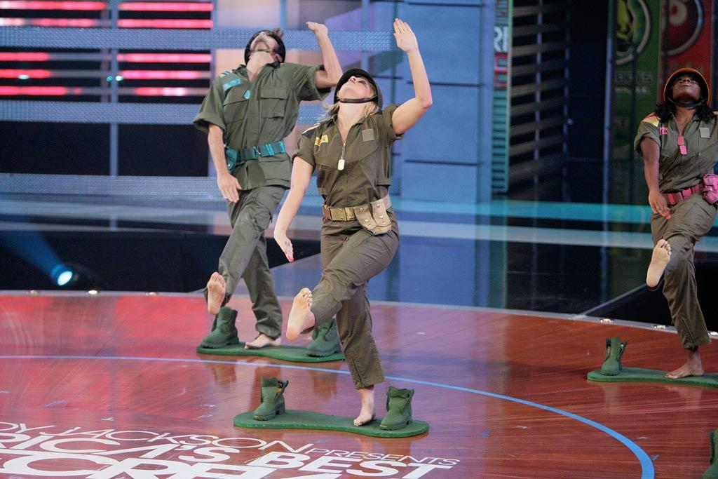 """YAHOO! TV: You did something totally unique and out of the box for the Rock the Title challenge when you danced to Britney Spears' """"Toy Soldier."""" *** FANNY PAK: Megan was the one who had the idea to do the boards to make it look like we were the little green toy soldiers. She actually had experience dancing in those boards before, so she was the lead in creating that routine. The remix of the music was also something that made that routine a success. We actually get our music first and we listen to it and if there's something we want added like sound effects, we can ask for that, but usually they give us a really good mix that we can work with it. The producers that we work with on music are geniuses. They make their own beats to match with each of the songs."""