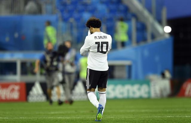 Egypt's Mohamed Salah leaves the pitch after the group A match between Russia and Egypt at the 2018 soccer World Cup in the St. Petersburg stadium in St. Petersburg, Russia, Tuesday, June 19, 2018. (AP Photo/Martin Meissner)
