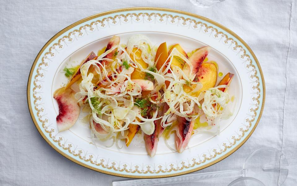 """Combining juicy sweetness and cool crunch, this peach recipe has summer written all over it. It's best made at the peak of the season, too, when peaches are at their sweetest. <a href=""""https://www.epicurious.com/recipes/food/views/peaches-and-shaved-fennel-salad-with-red-pepper?mbid=synd_yahoo_rss"""" rel=""""nofollow noopener"""" target=""""_blank"""" data-ylk=""""slk:See recipe."""" class=""""link rapid-noclick-resp"""">See recipe.</a>"""