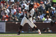 San Francisco Giants' Brandon Crawford hits an RBI-single against the Houston Astros during the sixth inning of a baseball game in San Francisco, Saturday, July 31, 2021. (AP Photo/Jed Jacobsohn)