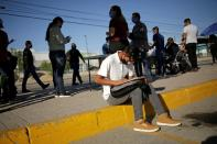 A job seeker fills out job application forms for assembly factories as the coronavirus disease (COVID-19) outbreak continues in Ciudad Juarez