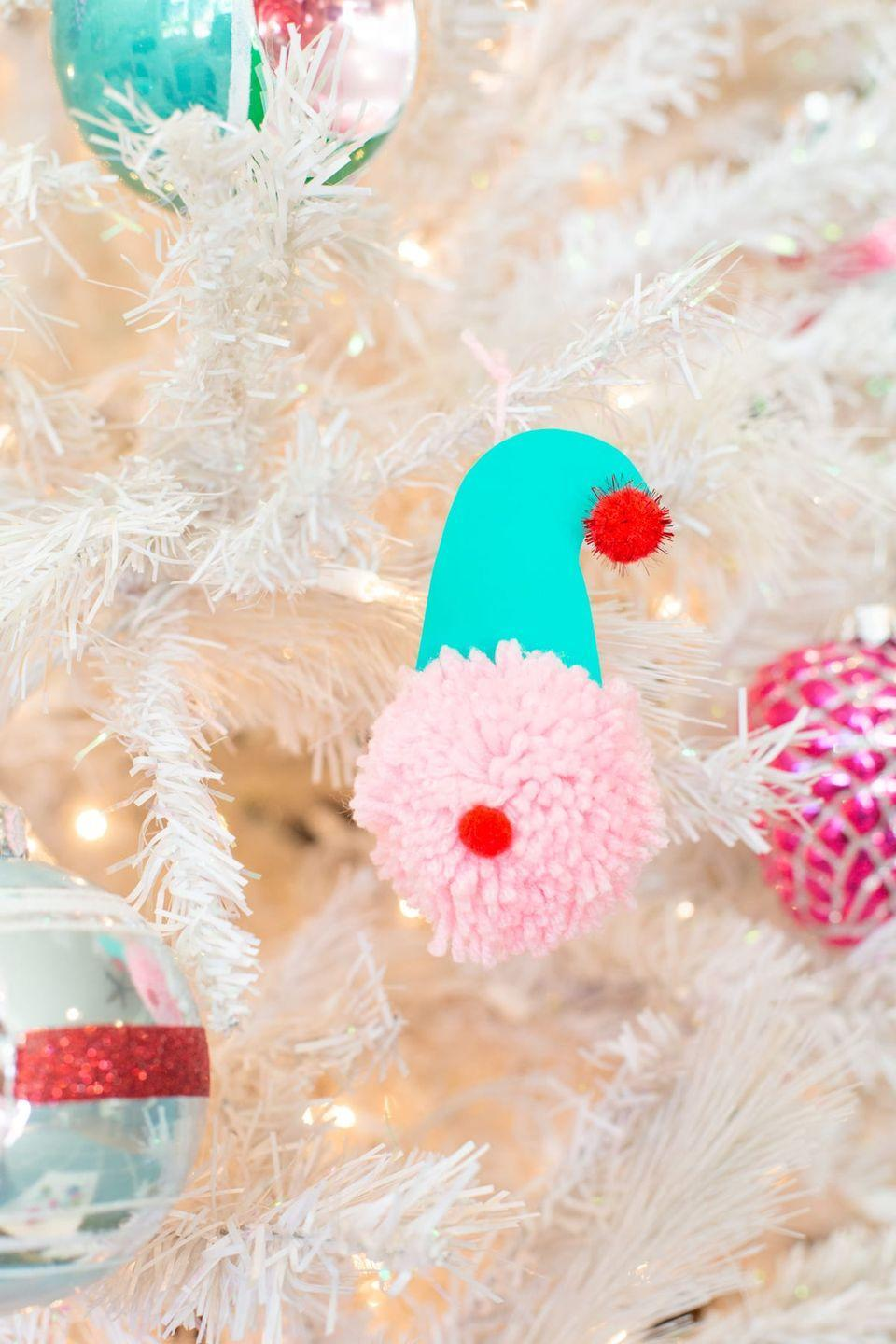 """<p>Make your own pom-pom-tastic Santas, reindeer, elves, and more with these adorable ornaments. The instructions include steps to make your own pom-poms too!</p><p><strong>Get the tutorial at <a href=""""https://lovelyindeed.com/pom-pom-christmas-ornaments-family-holiday-tradition/"""" rel=""""nofollow noopener"""" target=""""_blank"""" data-ylk=""""slk:Lovely Indeed"""" class=""""link rapid-noclick-resp"""">Lovely Indeed</a>.</strong></p><p><strong><a class=""""link rapid-noclick-resp"""" href=""""https://www.amazon.com/Pompom-Different-Pom-pom-Weaver-Knitting/dp/B01N4BKCC5/ref=sr_1_4?tag=syn-yahoo-20&ascsubtag=%5Bartid%7C10050.g.1070%5Bsrc%7Cyahoo-us"""" rel=""""nofollow noopener"""" target=""""_blank"""" data-ylk=""""slk:SHOP POM-POM MAKERS"""">SHOP POM-POM MAKERS</a><br></strong></p>"""