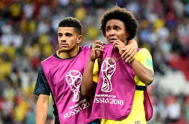 <p>Taison of Brazil consoles teammate Willian of Brazil following their sides defeat in the 2018 FIFA World Cup Russia Quarter Final match between Brazil and Belgium at Kazan Arena on July 6, 2018 in Kazan, Russia. (Photo by Michael Regan – FIFA/FIFA via Getty Images) </p>