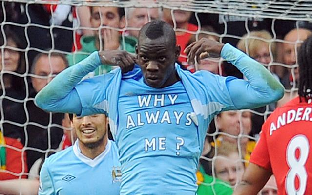 <span>Balotelli displaying his famous 'Why always me?' slogan after scoring in the Manchester derby, addressing the media's scrutiny of his off-field behaviour</span>