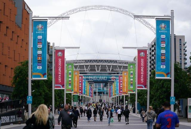 The first fans have started arriving outside Wembley Stadium ahead of the Euro 2020 semi-final