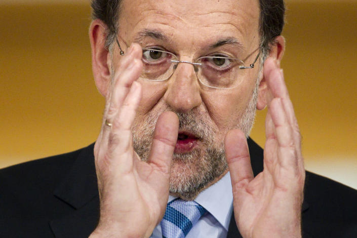Spain's Prime Minister Mariano Rajoy speaks during a press conference at the Moncloa Palace, in Madrid, Sunday, June 10, 2012. Spain became the fourth and largest country to ask Europe to rescue its failing banks, a bailout of up to 100 billion euros ($125 billion) that leaders hoped would stabilize a financial crisis that threatens to break apart the 17-country eurozone. (AP Photo/Daniel Ochoa de Olza)