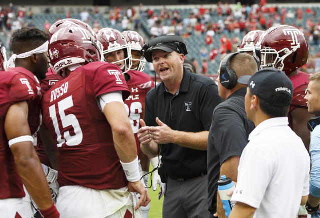 Temple head coach Rod Carey talks things over with his team before the final play in the second half of an NCAA college football against Maryland, Saturday, Sept. 14, 2019, in Philadelphia. Temple won 20-17. (AP Photo/Chris Szagola)