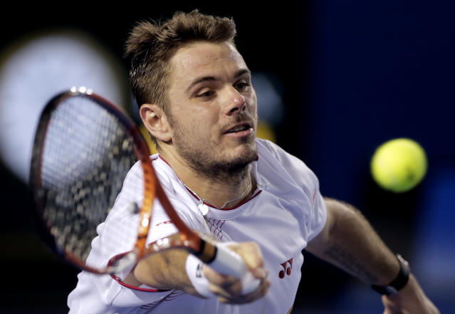 Stanislas Wawrinka of Switzerland makes a forehand return to Tomas Berdych of the Czech Republic during their semifinal at the Australian Open tennis championship in Melbourne, Australia, Thursday, Jan. 23, 2014.(AP Photo/Rick Rycroft)