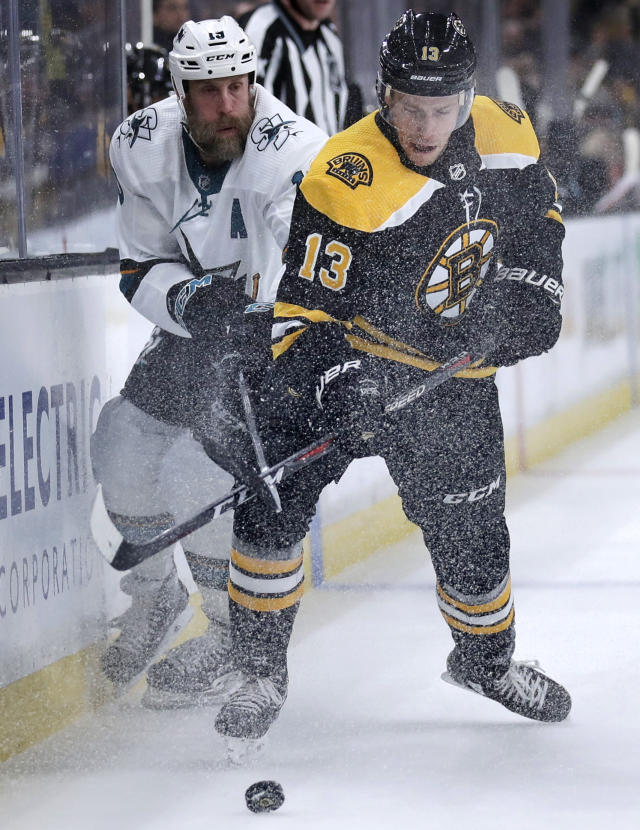 Boston Bruins center Charlie Coyle (13) battles for the puck with San Jose Sharks center Joe Thornton, left, during the second period of an NHL hockey game in Boston, Tuesday, Feb. 26, 2019. (AP Photo/Charles Krupa)