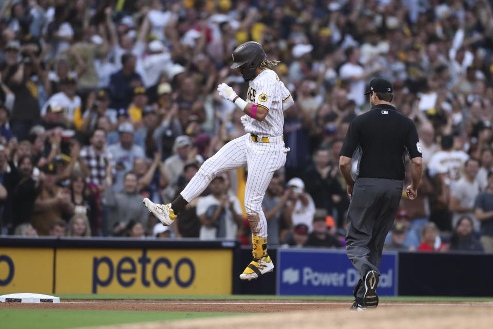 San Diego Padres' Fernando Tatis Jr. celebrates as he runs the bases on a solo home run against the Cincinnati Reds during the sixth inning of a baseball game Thursday, June 17, 2021, in San Diego. (AP Photo/Derrick Tuskan)