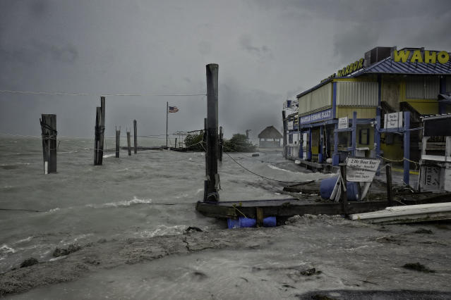 <p>Rough surf churned up buy the approaching hurricane damage the docks at Whale harbor in the Florida Keys as winds and rain from the outer bands of Hurricane Irma arrive in Islamorada, Fla., on Sept. 9, 2017. (Photo: Gaston De Cardenas/AFP/Getty Images) </p>