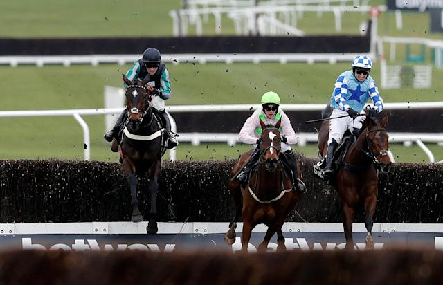 Horse Racing - Cheltenham Festival - Cheltenham Racecourse, Cheltenham, Britain - March 14, 2018 Altior ridden by Nico de Boinville (L) before going on to win the 15:30 Betway Queen Mother Champion Chase REUTERS/Darren Staples