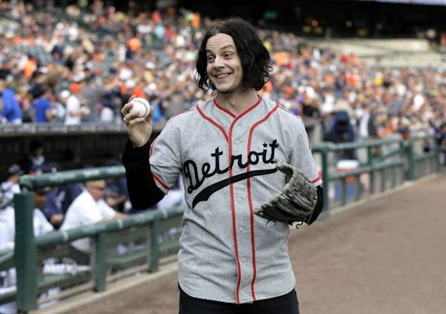 "Musician <a class=""link rapid-noclick-resp"" href=""/ncaaf/players/258962/"" data-ylk=""slk:Jack White"">Jack White</a> shows off a baseball before throwing out the ceremonial first pitch before the <a class=""link rapid-noclick-resp"" href=""/mlb/teams/det/"" data-ylk=""slk:Detroit Tigers"">Detroit Tigers</a> baseball game against the <a class=""link rapid-noclick-resp"" href=""/mlb/teams/chw/"" data-ylk=""slk:Chicago White Sox"">Chicago White Sox</a> Tuesday, July 29, 2014, in Detroit. (AP Photo)"