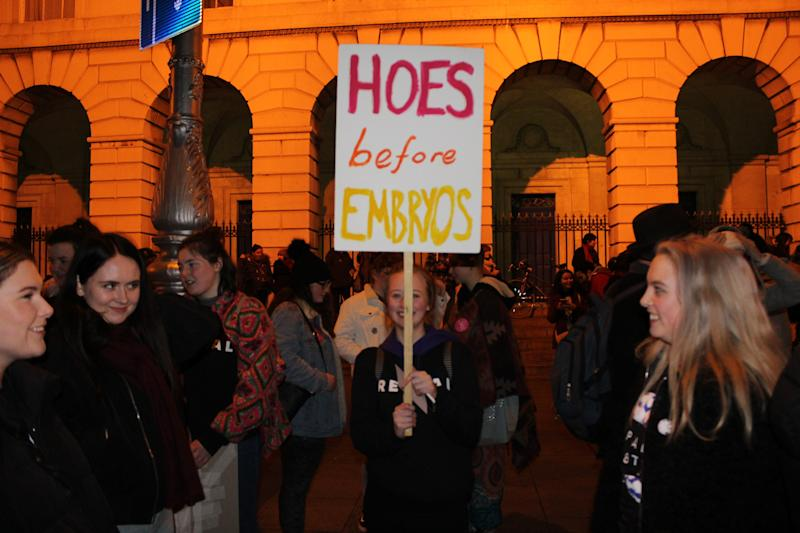 "A protester raises a sign that reads ""hoes before embryos"" at the pro-choice rally. (Jesselyn Cook/HuffPost)"