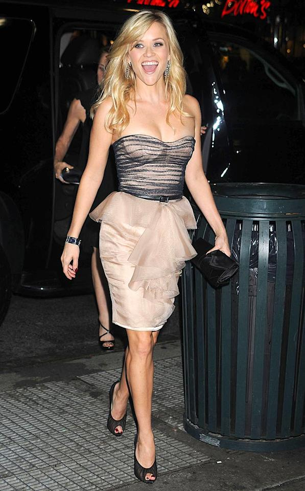 "Positively glowing with energy, Reese Witherspoon turned heads in a blush and black Jason Wu frock paired with peep-toe heels and a matching clutch at the Avon Foundation for Women Gala in NYC Tuesday. <a href=""http://www.splashnewsonline.com"" target=""new"">Splash News</a> - October 26, 2010"